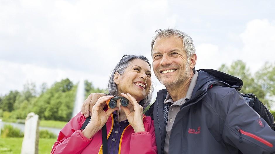 Man woman outdoors binoculars